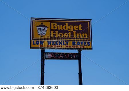 Mankato, Minnesota - June 5, 2020: Sign For A Budget Host Inn With Vacancy, A Cheap Motel Chain Know