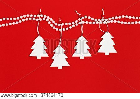 White Wooden Christmas Tree Hanging On Decor Pearl Beads. New Years And Christmas Minimal Greeting C