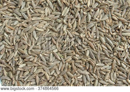 Cumin Seeds Close Up Background Texture Image.