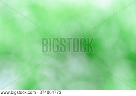 Green Blur Background From Nature. Natural Environmental Fon Or Backdrop.