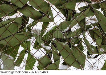 Camouflage Netting. Mesh Fence Protection Military Camouflage Background.