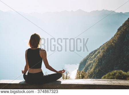 Young Woman Is Meditating In Mountains.