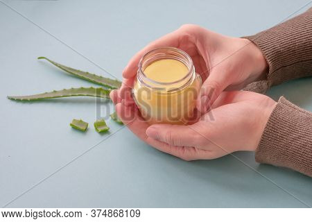 Young Female Hands Are Holding Translucent Glass Jar With Cream Made Of Wax And Aloe Essence.revital