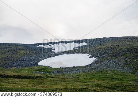 Minimalist Highland Landscape With Snowfield On Mountain Pass. Minimal Alpine Scenery With Snow On M