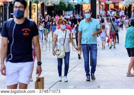 Andorra La Vella, Andorra : 2020 July 06 : People Walk In The Comercial Street Named Meritxell After