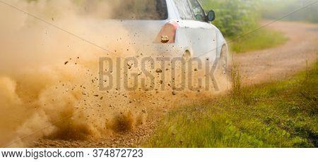 Gravel Splashing From Rally Car Drift On Dirt Track