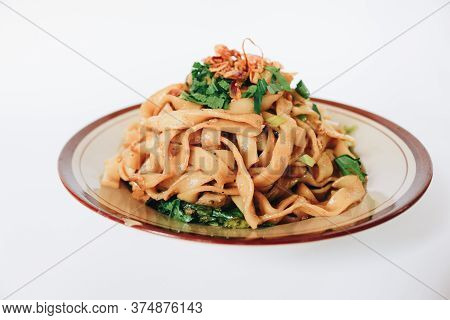 Stir Fried Flat Noodle And Pork With Dark Soy Sauce. Indonesia Said Called Bakmie Jowo Or Fried Kwet