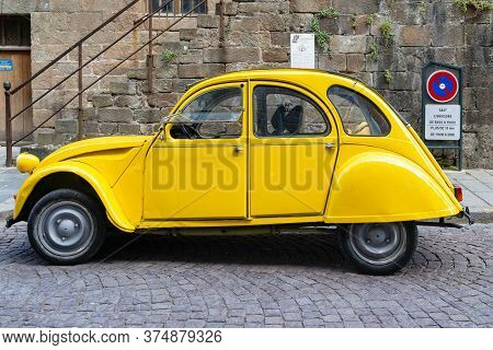Saint-malo, France - September 4. 2019: This Is An Old Yellow Citroen Citroen 2 Cb, The Legend Of Th