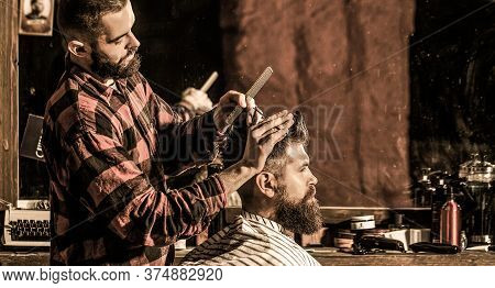 Work In The Barber Shop. Hairdresser Cutting Hair Of Male Client. Hairstylist Serving Client At Barb