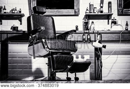 Barbershop Theme. Hairstylist In Barber Shop Interior. Black And White. Barber Shop Chair. Stylish V