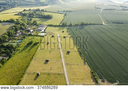 Stunning Drone Landscape Image Over Lush Green Summer English Countryside During Late Afternoon Ligh