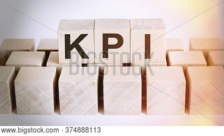 Kpi Word From Wooden Blocks On Desk, Search Engine Optimization Concept