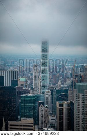Tall Building Standing Out Of Cityscape In Nyc