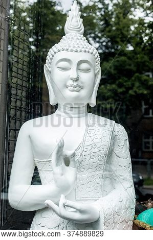 Buddha Statue Buddha Image Used As Amulets Of Buddhism Religion. On The European Streets. Hands