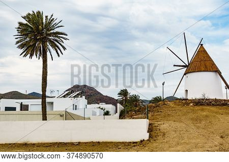 Wind Powered Water Mill In Spanish Village Of Las Negras, In The Cabo De Gata Nijar National Park, A