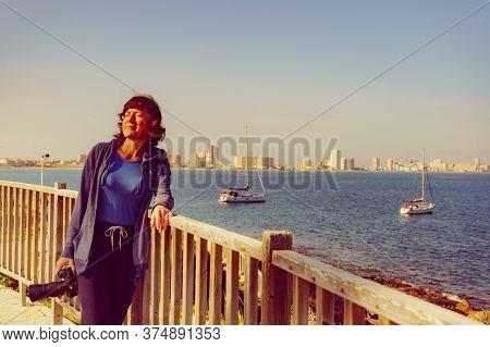 Tourist Woman Visit Cape Palos, Cartagen Murcia Region, Spain. Female Walking On Seashore, Enjoy La