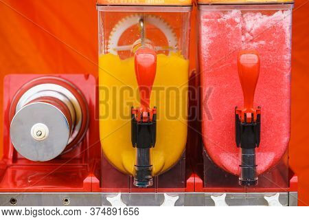 Close Up Of Slush Machine. Slushy Ice Made Colorful Drink Refreshing During Summer