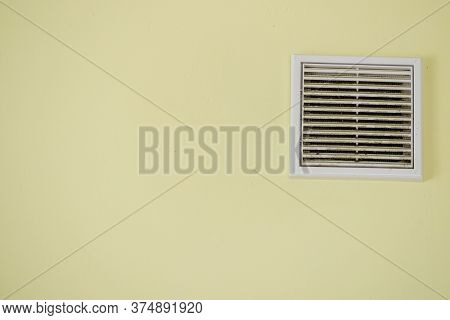 Home Details Concept. View Of Yellow Wall With Vent System. Interior Cooling Device.