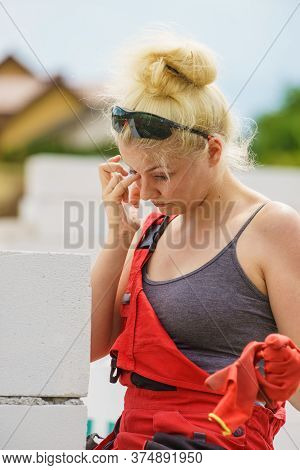 Tired Woman Crying On Construction Site
