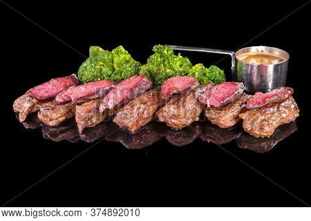 A Delicious Beef Fillet With Chorizo And Pepper Sauce With Reflection, Isolated On Black Background