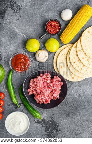 Traditional Homemade Taco Ingredients With Meat Over Grey Background, Top View.