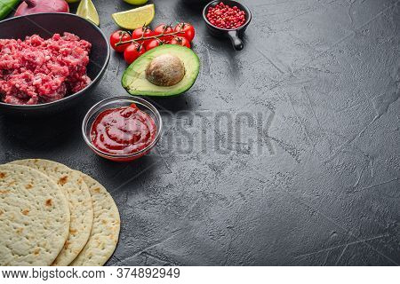 Traditional Mexican Tortilla With A Mix Of Ingredients, Corn, Meat, Vegetables, Salsa, Sauce Over Bl
