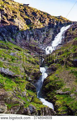 Trolls Path Trollstigen Scenic Mountain Road In Norway Europe. Viewing Platform Over Waterfall And B