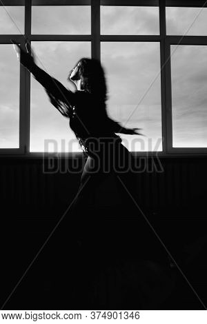 Spiritual Dance. Vitality Energy. Inspired Woman Silhouette Freedom Performance With Motion Blur And