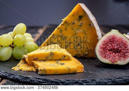 British Matured Yellow Cheese Blue Shropshire, Close Up On Black Stone