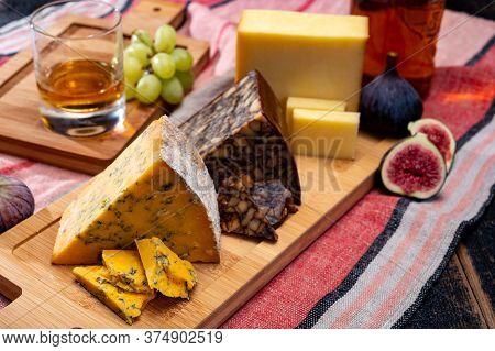 British And Irish Cheeses, Tasting Plate With Blue Shropshire, Brown Porter Cheese And Smoked Chedda