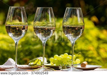 Tasting Of Pinot Gridgio Rose Wine On Winery Terrace In Veneto, Italy. Glasses Of Cold Dry Wine Serv