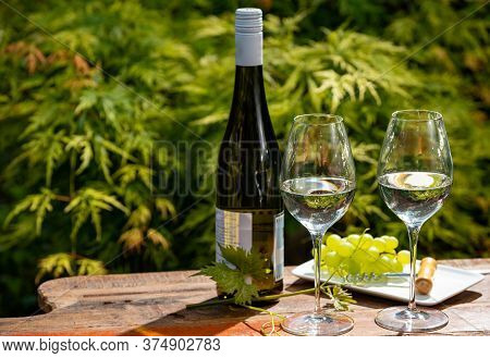 Quality Wine Tasting On Winery In Mosel Wine Redion In Germany, Two Glasses And One Bottle Of Riesli