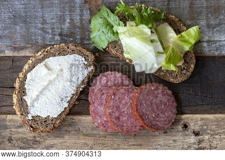 Closeup Of Bread With Horseradish Spread And Salami