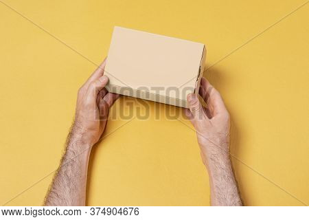 Male Hand Holding A Small Gift Box, Mock-up Series Template Ready For Your Design, Selection Path In