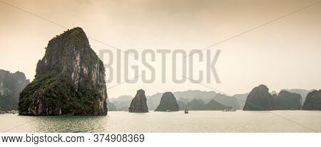 Limestone Karst Islands On A Misty Day In The The Unesco World Heritage Site Of Ha Long Bay, In Viet