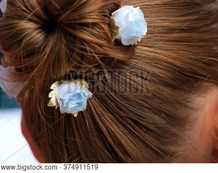 Blond Hair Is Combed Smoothly, Piled In A Ponytail, Twisted And Stabbed With Hairpins Decorated With