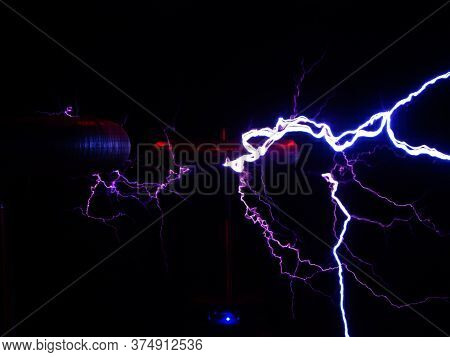 Electric Discharge Of Lightning With The Outlines Of Electric Coils In The Dark. Noise, Film Grain