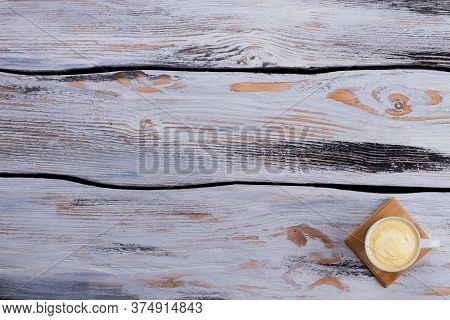 Coffee Mug With Foam On Wooden Table. Topview Flat Lay Copy Space.