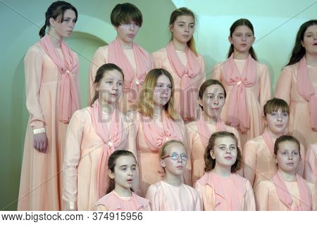 Performance Of The Children's Choir On The Stage. Children's Theatrical Creativity, Choreography And