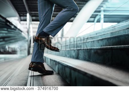 Motivation And Challenging Concept. Steps Forward Into A Success. Low Section Of Businessman Walking