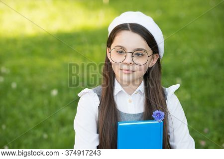 Nature Study. Serious Child Study On Natural Landscape. Small Girl Hold Book Outdoors. Study And Edu