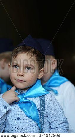 Portrait Of Boys In White Shirts And Blue Neckerchief In Kindergarten