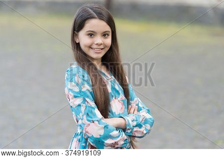 Stunning Girl. Happy Girl With Cute Smile Outdoors. Fashion Look Of Girl Child. Little Girl With Lon