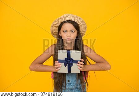 Shouldnt Your Purchase Be Unique Too. Serious Child Hold Gift Box. Holiday Celebration. Gift Shop. P