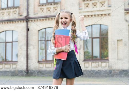 Childrens Future. Concept Of Education And Reading. Development Of Imagination. Cute Girl Hold Noteb
