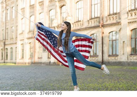 Patriotic Upbringing. Patriotic Child Hold American Flag Outdoors. Little Patriot Celebrate Independ