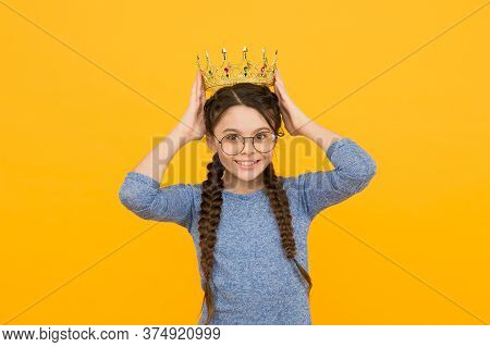 Shine The Success. Happy Child Wear Crown Yellow Background. Little Beauty Queen. Success And Triump