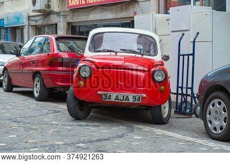 Istanbul, Turkey - January 03, 2015: Red And White Fiat 600 (fiat Seichento) On A City Street A Clou