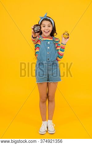 Cute Little Girl With Tasty Muffins. Small Kid Eating A Delicious Cake. Summer Vacation Holiday. Muf