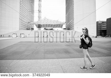 Summer Vacation. Sightseeing Guide. Girl Tourist Sunglasses Enjoy City Center Square. Woman Stand In
